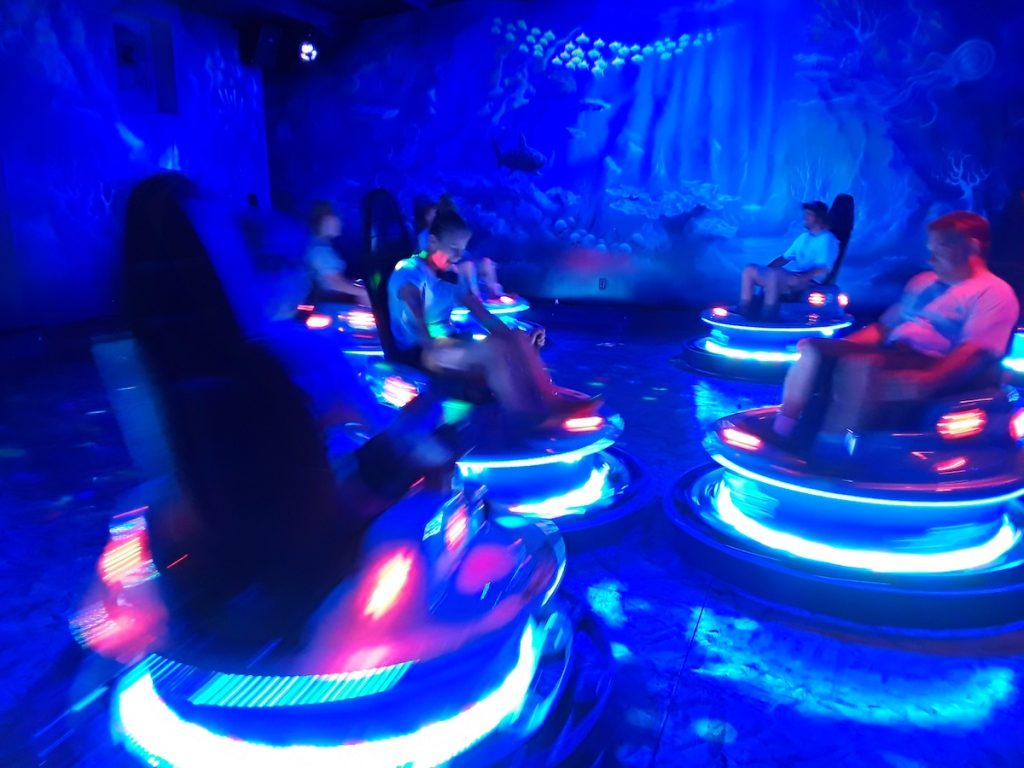 Riders driving computerized bumper cars at Swampy Jack